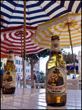 Italian cafe with beer and umbrellas.